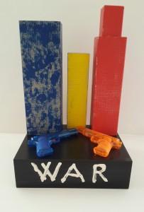 Autore Leonardo Pappone Leopapp Titolo opera War is not a game; 54x35x30 cm; installazione multimaterica su legno. Anno 2016 .20160924_115940-1