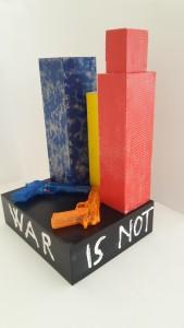 Autore Leonardo Pappone Leopapp Titolo opera War is not a game; 54x35x30 cm; installazione multimaterica su legno. Anno 2016 20160924_120044(0)